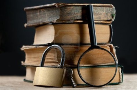 12458059-pile-of-old-books-with-keylock-and-magnifying-glass